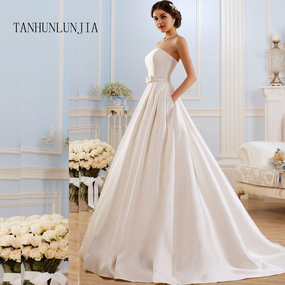 2020 A Line Wedding Dresses  Vintage Pockets Bow China Vestidos De Novia Backless Plus Size Button Bride Bridal Gowns