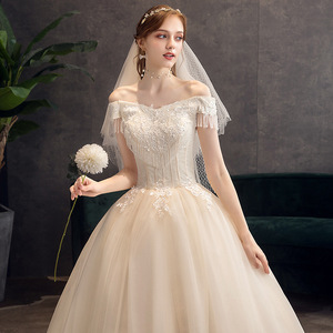 Image 4 - קלאסי שמפניה 2019 חדש חתונת שמלה אלגנטי סירת צוואר כבוי כתף תחרה ואגלי טאסל Slim כדור שמלת חלוק דה mariee