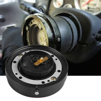 Quick release removable car steering wheel hub boss adapter kit  Snap off.