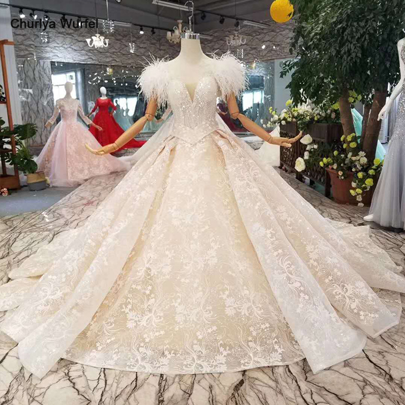 LS11006 Ostrich feather wedding dresses with belt 2019 new design appliques shiny lace gowns sashes free shipping