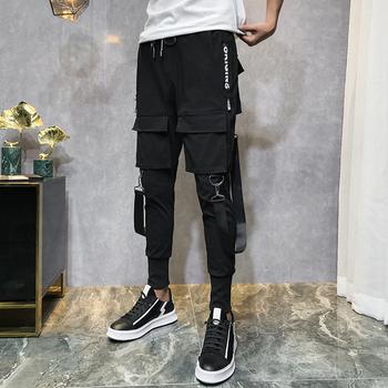 2019 mężczyźni Streetwear spodnie czarne spodnie Harem lekkie męskie punkowe spodnie wstążki Casual Slim spodnie do biegania męskie spodnie hip hopowe LBZ138 tanie i dobre opinie linfengxiangzi Harem spodnie Pełnej długości Mieszkanie Poliester Midweight Suknem REGULAR Elastyczny pas Full Length