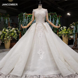 Image 1 - HTL990 lace wedding dress in Wedding Dresses o neck short sleeved bead wedding gowns with tail illusion back vestidos de noivas