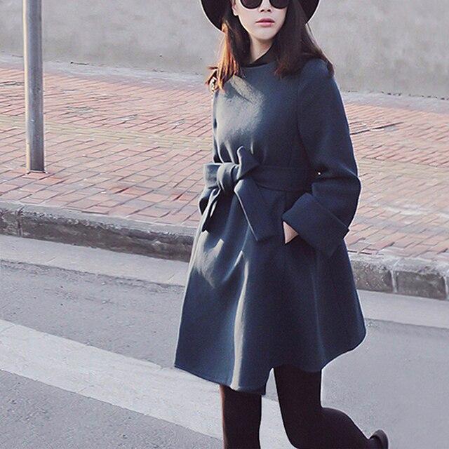 Фото 2020 осенне зимнее модное женское шерстяное пальто с бантом