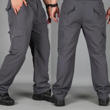 Męskie kombinezony wojskowe wojskowe spodnie bojówki jesienne bawełniane workowate dorywczo spodnie męskie multi-kieszenie zwykłe długie spodnie Plus rozmiar 4XL tanie i dobre opinie summer Proste CN (pochodzenie) POLIESTER CASUAL W stylu safari Mieszkanie Z KIESZENIAMI REGULAR Pełna długość MEN PANTS