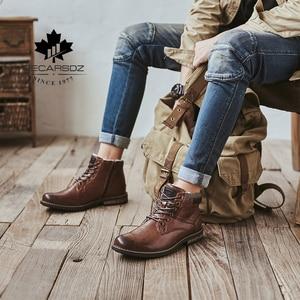 Image 4 - Decarsdz男性雪のブーツ男性tpr耐久性のあるアウトソール革2020新ファッションショートぬいぐるみ暖かい毛皮冬のブーツ男性のブーツ