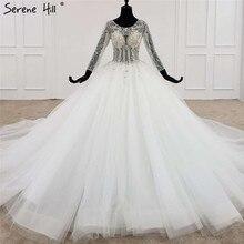 Blanc haut de gamme o cou Sexy robes de mariée 2020 luxe diamant perles à manches longues robe de mariée HX0107 sur mesure