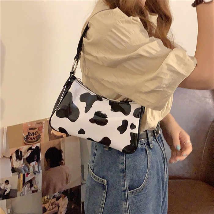 RAVIDINO VINTAGE PUหนังผู้หญิงBaguetteกระเป๋าถือแฟชั่นรูปแบบนมวัวสุภาพสตรีใต้วงแขน