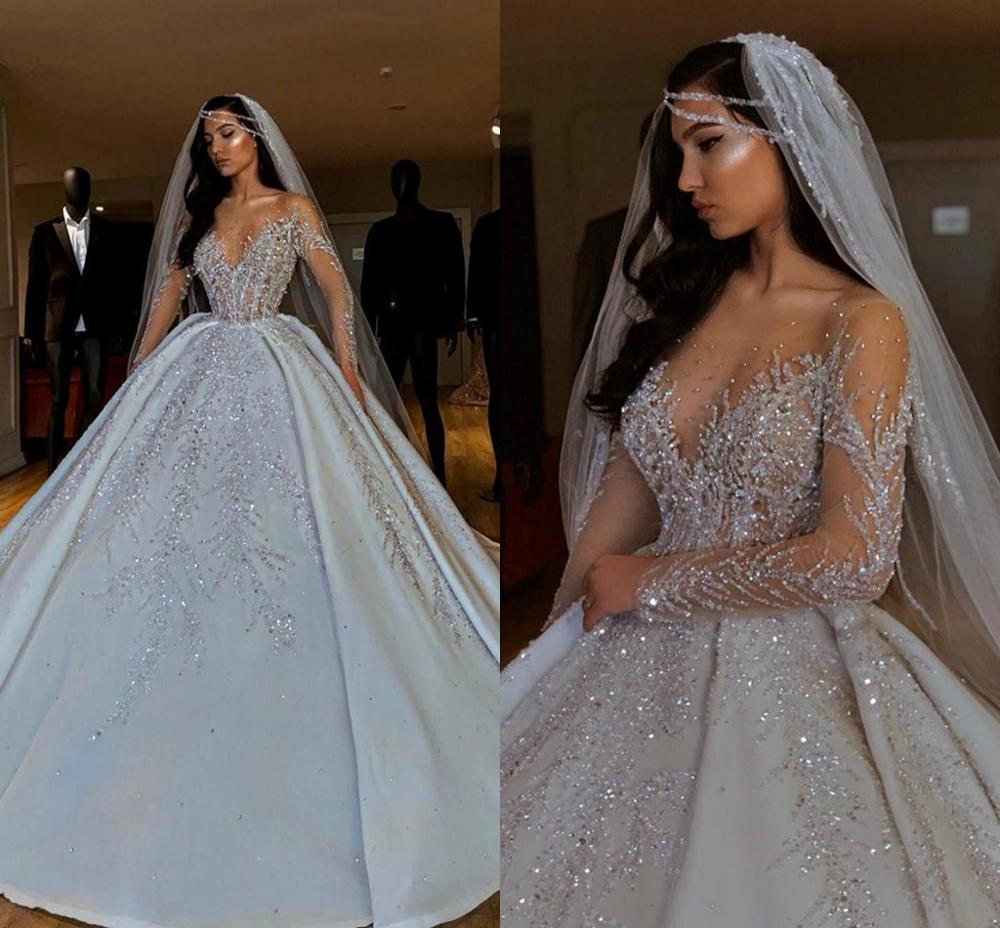 Luxury Sparkly African Wedding Dresses 10 Sheer Neck Long Sleeves Bridal  Dresses Beaded Sequins Satin Puffy skirt Wedding Gown