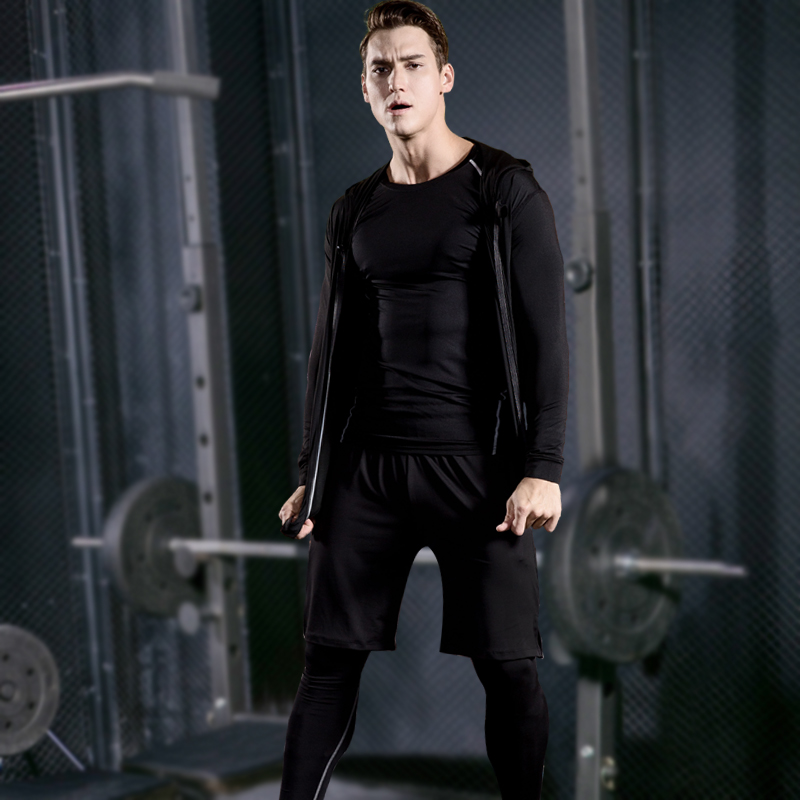 Foto in gym 5 pcs compressions clothes for gym. Men's 5 pcs compression tracksuit sports