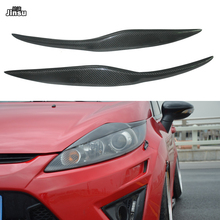 цена на Carbon Fiber Headlights Eyebrows Eyelids Car Stickers For Ford Fiesta MK7 2009 - 2012 Racing style Front Headlamp Eyebrows 2pcs