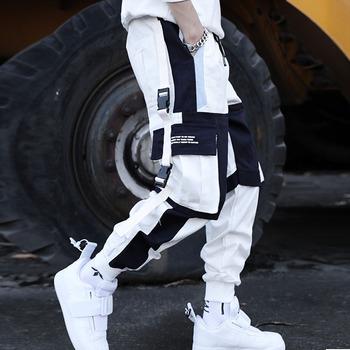 Nowa w stylu Streetwear męskie wiele kieszeni haremki bojówki spodnie Hip Hop na co dzień mężczyzna spodnie do biegania spodnie do biegania moda Harajuku męskie spodnie tanie i dobre opinie VSRONK Cztery pory roku Spodnie typu Harem CN (pochodzenie) COTTON Daily Mieszkanie Z KIESZENIAMI REGULAR Pełna długość