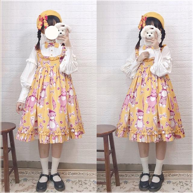 Фото платье в стиле лолиты с оборками и бантиком милое платье высокой