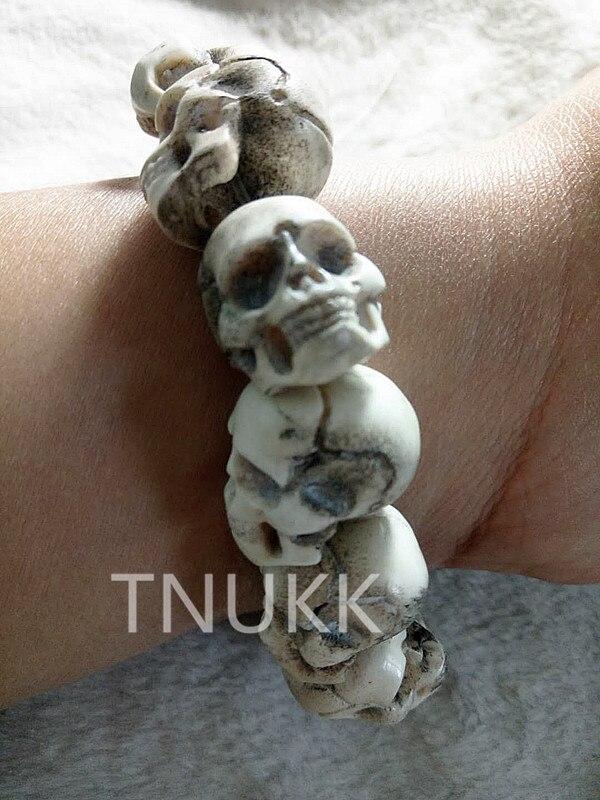 Exquisitas tallas auténticos huesos de ciervo pulseras de font b Calavera b font artesanías Regalos sorpresa