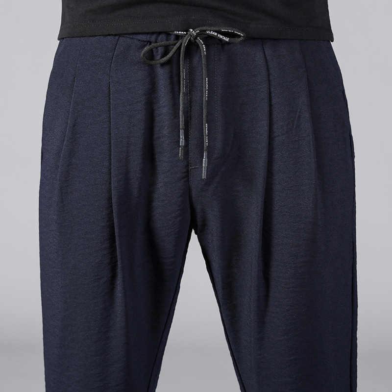 Hot sprzedaży mężczyźni rozciągliwy Smart Casual spodnie oddychające luźne spodnie sportowe