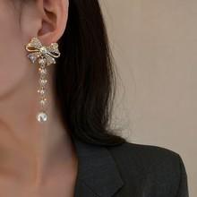 Mengjiqiao韓国エレガントなラインストーンちょう結びのドロップイヤリング女性ガールズファッションロングパールpendientesパーティージュエリーギフト