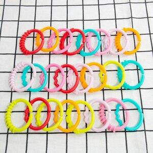 Image 2 - 8 pièces/ensemble en plastique arc en ciel anneau bébé jouets bébé dentition sucette nouveau nés hochets en caoutchouc berceau jouets poussette suspendus jouet chambre décor