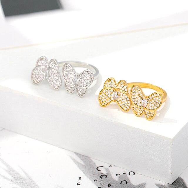 женское кольцо с бабочкой золотистое/серебристое обручальное фотография