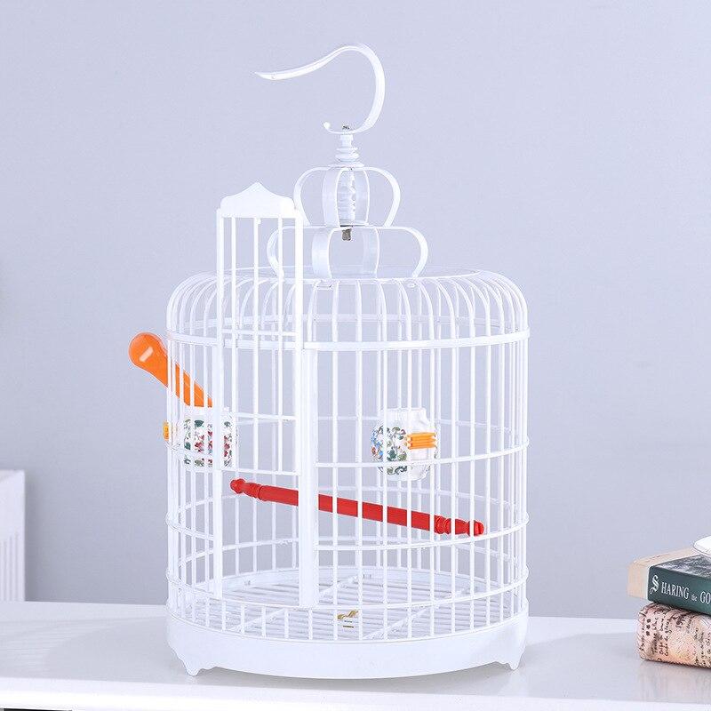 Perroquet Portable Pet oiseau maison moineau Jade jaune oiseau fournitures oiseau nid muguet Cage en plastique Cage à oiseaux avec des coquilles suspendues