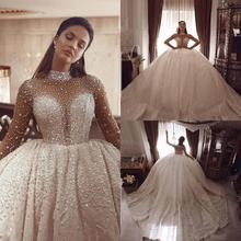 Luksusowa suknia balowa obszywana koralikami suknie ślubne długie rękawy kryształ wysoki kołnierz Plus rozmiar arabski suknie ślubne suknia w stylu Vintage De Marie