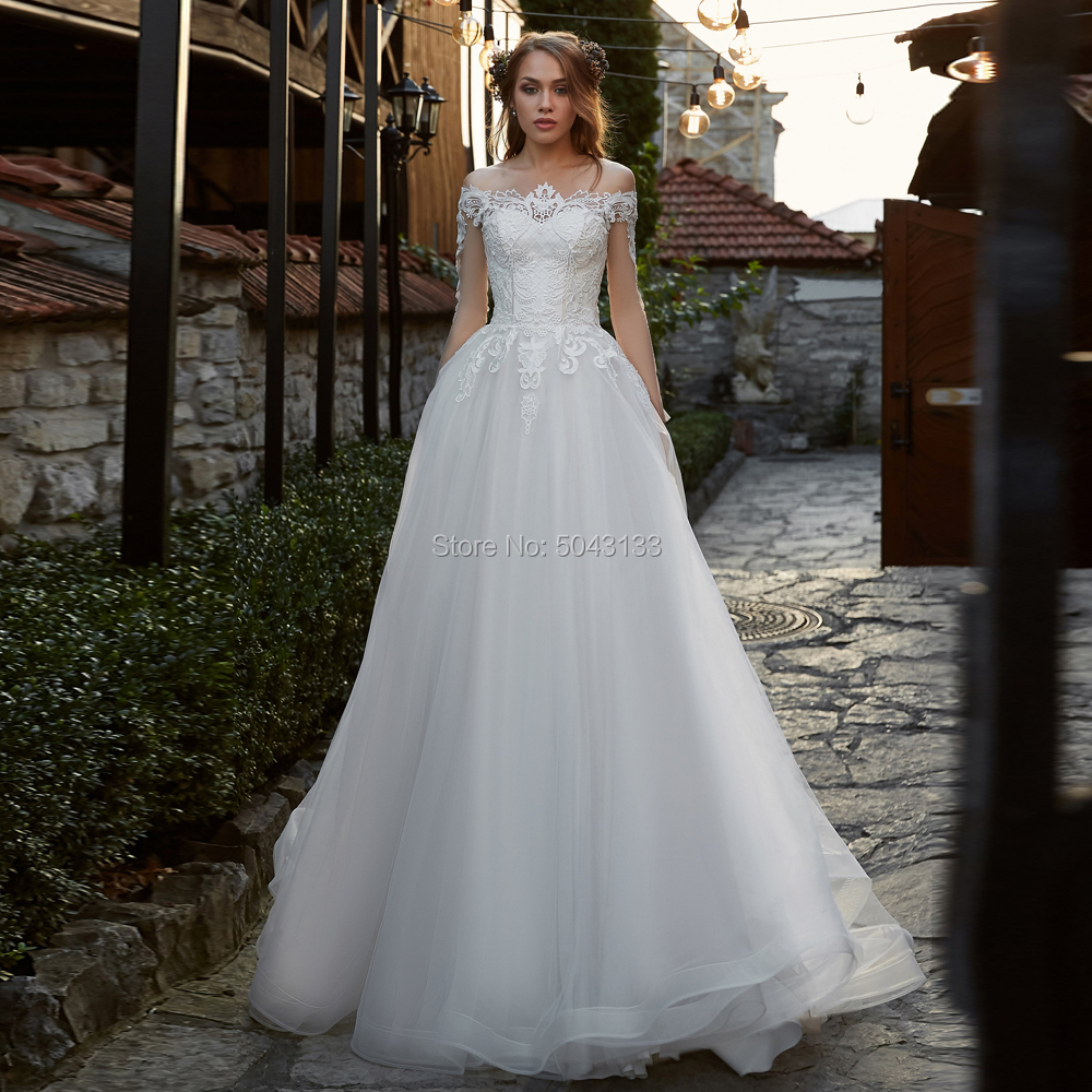 Chic Lace Applique A Line Wedding Dresses 2019 Boat Neck Cap Sleeve Soft Tulle Wedding Gowns Sweep Train Bride Dress