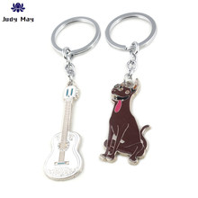 Movies COCO Guitar Dog Model Metal Keychain And Bag Pendant Jewelry Keyring Beautiful Gift(China)