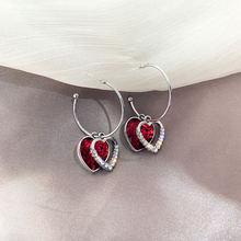 Женские серьги подвески с кристаллами в форме сердца