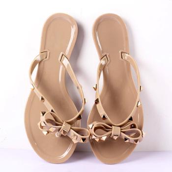 Hot 2019 moda klapki damskie letnie buty fajne plaża nity duża kokarda sandały na płaskim obcasie marki galaretki buty sandały dziewczyny rozmiar 36-41 tanie i dobre opinie ENLEN BENNA podstawowe Płaskie z Otwarta Mieszkanie (≤1cm) Na co dzień Wsuwane Dobrze pasuje do rozmiaru wybierz swój normalny rozmiar