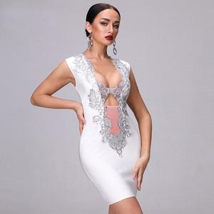 Image 3 - 2020 새로운 가을 고품질의 흰색 검은 민소매 깊은 v 목 장식 조각 중공 붕대 드레스 나이트 클럽 파티 크리스마스 드레스