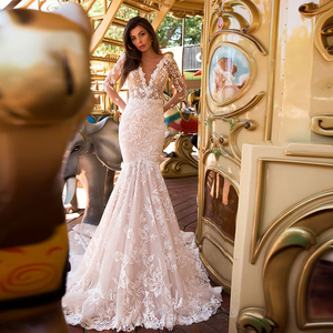 2020 New Arrive Long Sleeve Mermaid Wedding Dresses Vestido De Noiva Sereia Deep V-neck Backless Pearls Lace Sexy Trumpet Gowns