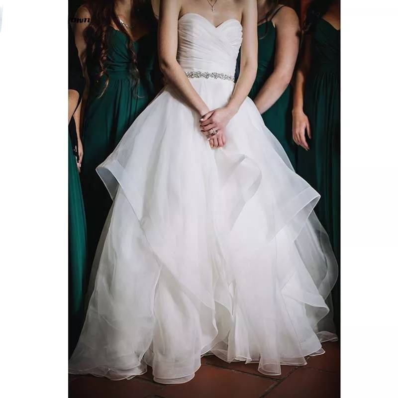 Organza Ruffles Ball Gown Wedding Dresses Sweetheart Sleeveless Long Bridal Dress Beaded Sash Sweep Train Wedding Gowns 2019