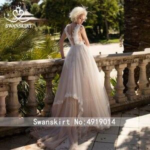 Image 2 - Fee V ausschnitt Perlen Hochzeit Kleid Strand Appliques Illusion Tüll A linie Ärmellose Swanskirt D121 Brautkleid Vestido de novia