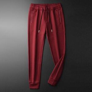 Image 2 - Minglu אדום Mens מכנסיים יוקרה רוכסן כיסים מוצק צבע מזדמן ספורט איש מכנסיים סתיו וחורף Slim Fit Man מכנסיים 4XL