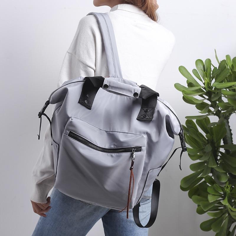 H5e27724ae9b9462ba15322b95fe0858f6 Casual Nylon Waterproof Backpack Women High Capacity Travel Book Bags for Teenage Girls Students Pink Satchel Mochila Bolsa 2019