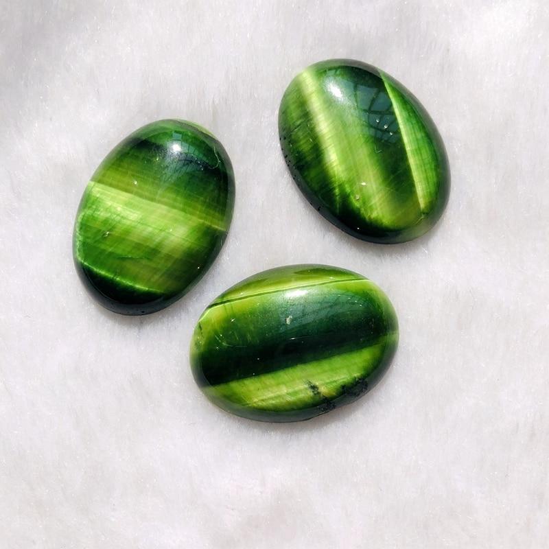 Natural\u00a0 green tourmaline Cabochon semiprecious stone in oval shape\u00a0