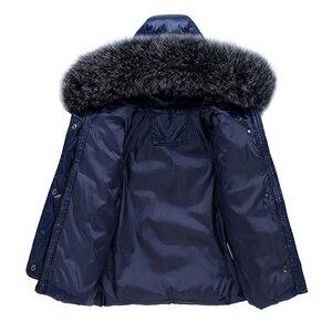 Image 3 -  30 traje de invierno para la nieve, conjunto de ropa para niños, chaqueta impermeable de plumón de pato blanco para bebés, abrigo para niñas y pantalones con babero, Parka para niños