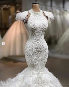 Image 2 - Echt Bild Luxus Feder Weiß Meerjungfrau Hochzeit Kleider 2020 Spitze Brautkleider Nach Maß Dubal Hochzeit Kleider