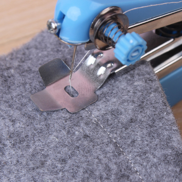 1PC Portable Mini Sewing Machine Manual Operation Sewing Tools Sewing Cloth Fabric Handy Needlework Tools