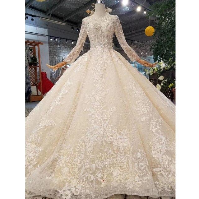 BGW HT43021 robe de mariée en cristal à la main Champagne col rond à manches longues Corset lacets dos robe de mariée avec longue mode de Train