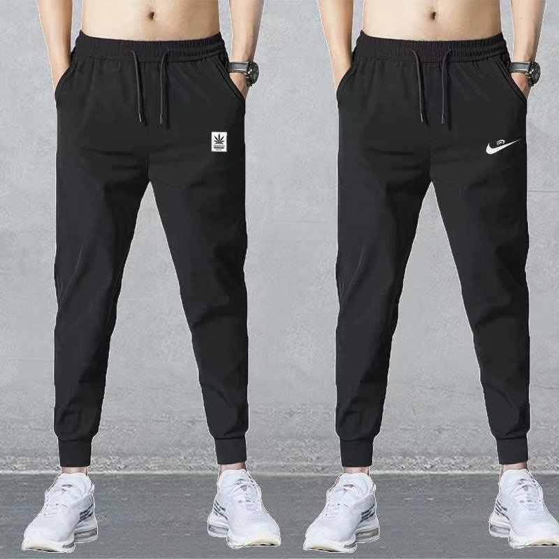 Pantalones casuales para hombre de sección delgada de verano Pantalones de secado rápido pantalones para hombre jóvenes transpirables Pantalones deportivos de gran tamaño anchos pantalones de aire