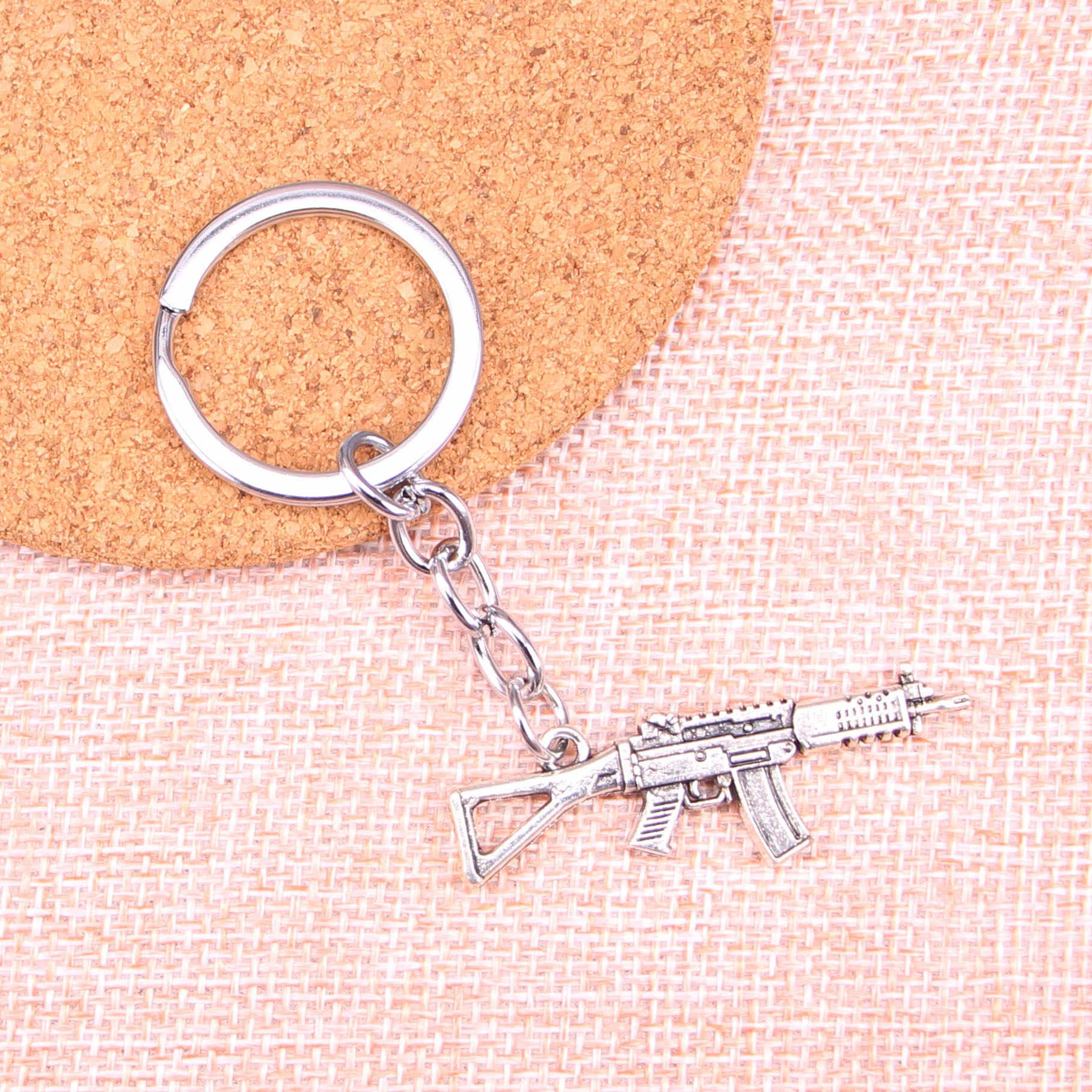 20pcs machine gun assault rifle Sleutelhanger 45*13mm Hangers Auto Sleutelhanger Ring Houder Sleutelhanger Souvenir Sieraden gift