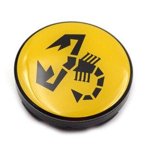 Image 4 - 20 pc/lot 56mm jaune Abarth emblème de voiture roue Center moyeu capuchon jante insigne couvre Scorpion roue central casquettes 5JA601151A