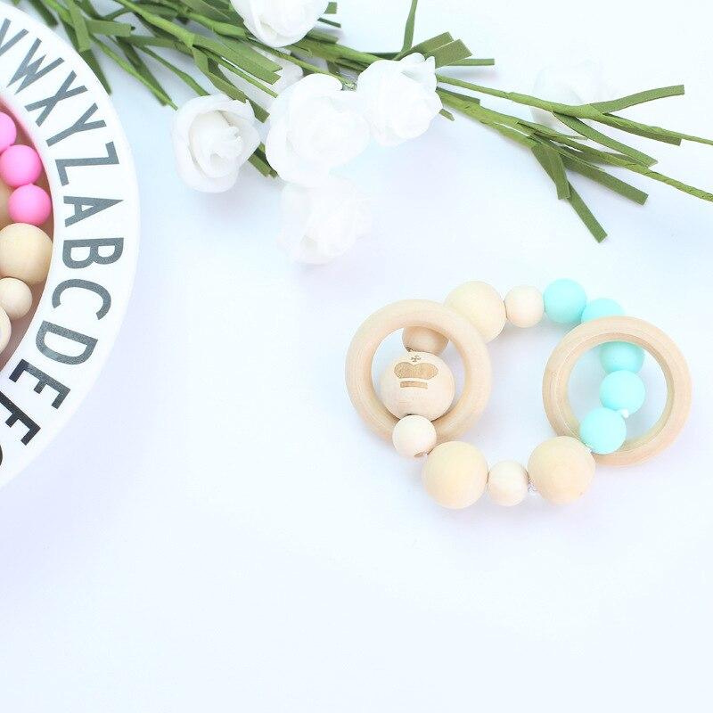 Hot Selling Infants Silica Gel Molar Bracelets Laser Smiley Wooden Beads Colorful Molar Rod Bracelet