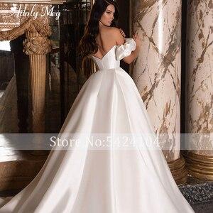 Image 5 - Adoly Mey New Romantic Boat Neck Backless A Line Wedding Dresses 2020 Graceful Satin Chapel Train Princess Bride Gown Plus Size