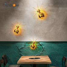 Postmodern background wall lamp light luxury creative spider restaurant cafe living room wall lamp