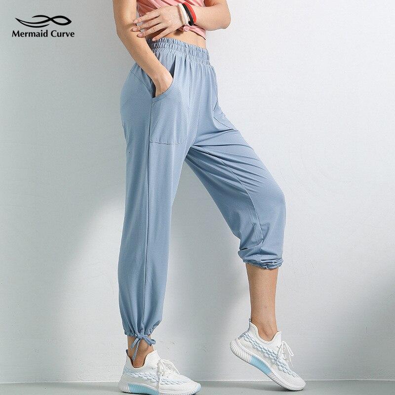 Русалка кривая Женская повязка на ногу тренировочные штаны шаровары длинные штаны для танцев быстросохнущие Высокая талия Свободные Летние тонкие стильные штаны для йоги Штаны для йоги      АлиЭкспресс