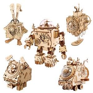 Image 1 - Robotime diy caixa de música relógio de madeira robôs criativos casa coelho barco mesa decoração presentes para crianças namorado am