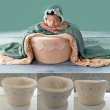 A newborn photography prop beige soft and comfortable sitting basket assisted photo accesso
