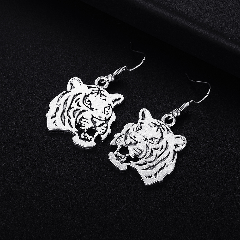 NEW. A PAIR OF SHORT DANGLY  TIBETAN SILVER CLIP ON  EARRINGS