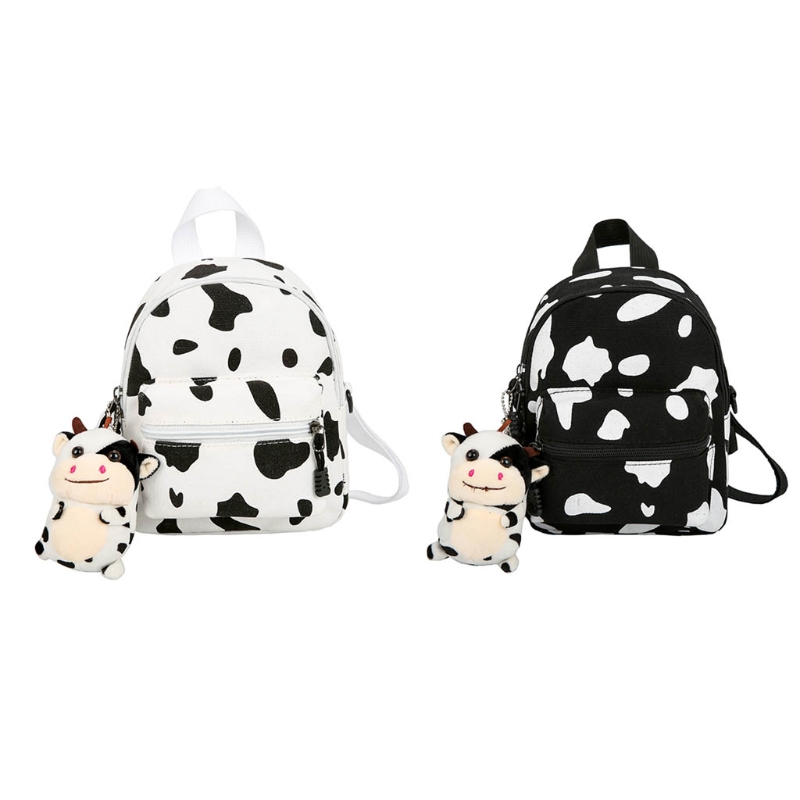 Small Canvas Daypack with Plush Pendant Black White Cow Print Backpack for Women Lady Girls Outdoor Travel Shopping Shoulder Bag
