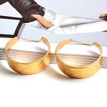 Pendientes redondos de Metal para mujer, aretes de gota de oro de alta calidad, moda al por mayor, accesorios de joyería para mujer